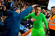 Ederson Moraes (31) of Manchester City goes to the City fans at full time after a 1-0 win over Bournemouth to hand his shirt to a fan as is give a pat on the head during the Premier League match between Bournemouth and Manchester City at the Vitality Stadium, Bournemouth, England on 2 March 2019.