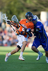 Virginia attackman Danny Glading (9) collides with Duke midfielder Michael Ward (9).  The #3 ranked Virginia Cavaliers fell to the #2 ranked Duke Blue Devils 19-9 at the University of Virginia's Klockner Stadium in Charlottesville, VA on April 12, 2008.