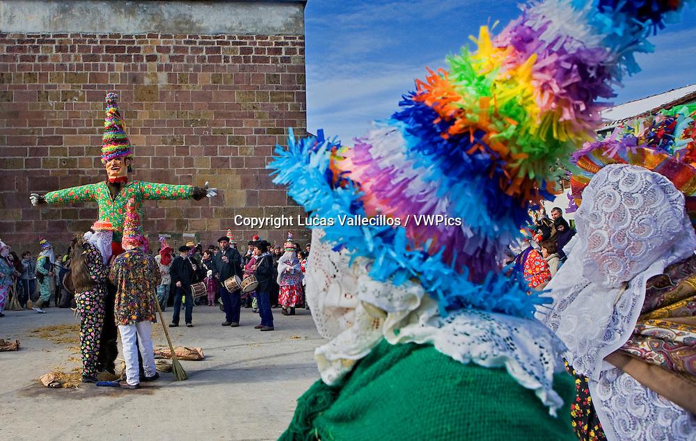 Miel Otxin and Txatxos dancing the Zortziko dance.In Frontón´. Lantz carnival. Navarra. Spain