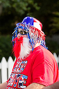 A bicyclist wearing patriotic costume rides past during the Sullivan's Island Independence Day parade July 4, 2015 in Sullivan's Island, South Carolina.