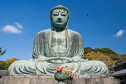 Offerings in front of the Daibutsu (Great Buddha) of Kamakura, Japan