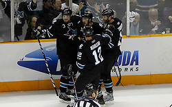 May 8, 2011; San Jose, CA, USA; San Jose Sharks right wing Devin Setoguchi (top, center) is congratulated after scoring a goal against the Detroit Red Wings during the first period of game five of the western conference semifinals of the 2011 Stanley Cup playoffs at HP Pavilion. Mandatory Credit: Jason O. Watson / US PRESSWIRE