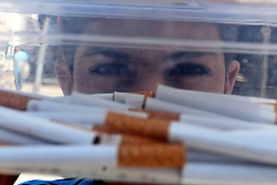 31.05.2015, Rafah, PSE, Tabakverkauf in Palästina, im Bild ein Palästinenser verkauft Zigaretten, teilweise selbst hergestellt. // A Palestinian street vendor sells cigarettes in the southern Gaza Strip. Smuggling through tunnels began several months after Islamic Hamas movement's control of the Gaza Strip and the Israeli blockade. This business flourished after the ouster of Egyptian President Hosni Mubarak in 2011, but declined since Egyptian President Mohamed Morsi was ousted and detained. Since then, 90 percent of the tunnels underneath the borders were destroyed, announced by Egyptian army and Hamas. A senior official in the Gaza ministry of finance said that the government in Gaza increased the taxes on smuggled cigarettes from Egypt as well as the cigarettes coming through Israel to help getting out of a financial crisis, Palestine on 2015/05/31. EXPA Pictures © 2015, PhotoCredit: EXPA/ APAimages/ Abed Rahim Khatib<br /> <br /> *****ATTENTION - for AUT, GER, SUI, ITA, POL, CRO, SRB only*****