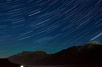 Night Sky, Star Trails, and Northern Lights looking northeast from Haines, Alaska. Composite of images from 23:30 to 23:59 taken with a Nikon D3x camera and 45 mm f/2.8 PC-E lens (ISO 400, 45 mm, f/5.6, 29 sec). Raw images processed with Capture One Pro and the composite generated using Photoshop CC (statistics, maximum).