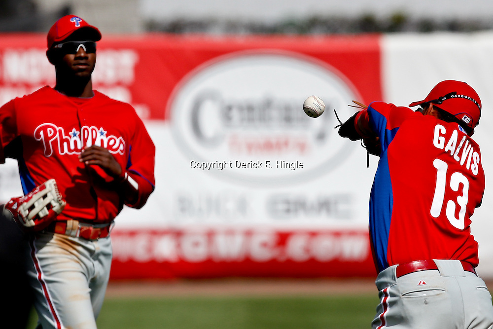 March 4, 2012; Tampa Bay, FL, USA; Philadelphia Phillies shortstop Freddy Galvis (13) is unable to handle a fly ball over his head during spring training game against the New York Yankees at George M. Steinbrenner Field. Mandatory Credit: Derick E. Hingle-US PRESSWIRE