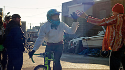 Philadelphia, PA, USA - December 21, 2014; Each year a group cycling enthusiasts converge on a junkyard in North Philadelphia to race each other on dirt paths winding between junk cars at the annual Bilenky Cyclocross event.<br />