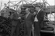 23/09/1963<br /> 09/23/1963<br /> 23 September 1963<br /> Minister sees advances in peat productivity by Bord na Mona. Picture shows the Minister for Transport and Power, Mr Erskine Childers (centre) inspecting a sod loading machine  at Timahoe turf works, during his end of season visit to Bord na Mona installations. Also in the picture are Mr Dermot Lawlor, (left)  Managing Director, Bord na Mona and Mr Eugene Redehan, Chief Civil Engineer, Bord na Mona.