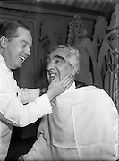 Mr Noel Purcell having his beard removed for Pantomime - Special for Radio Review.<br />
