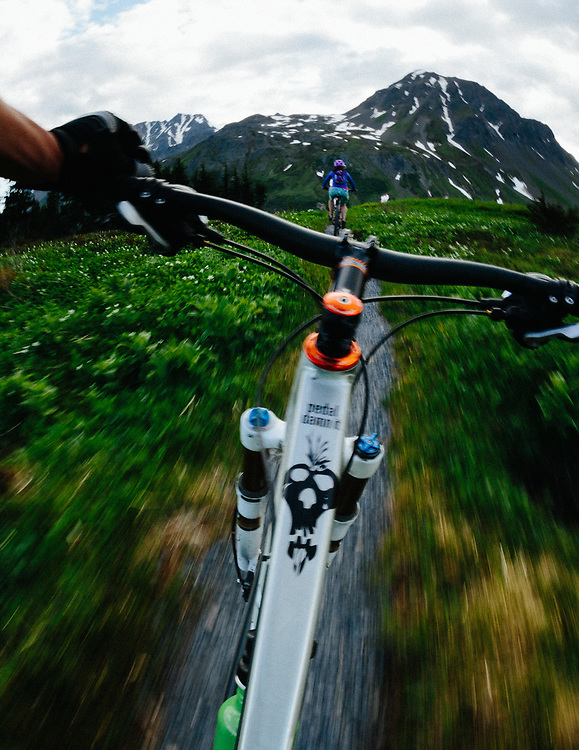 Jay and Heather Goodrich ride from a point of view perspective along the Lost Lake Trail near Seward, Alaska.