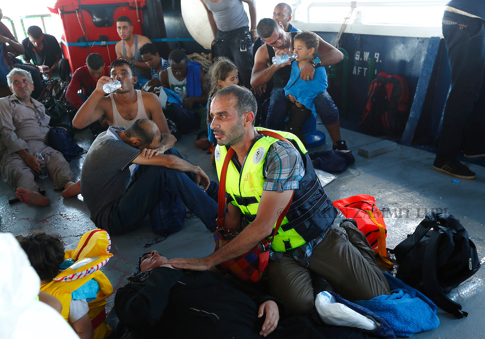 Migrants rest on the lower deck of the Migrant Offshore Aid Station (MOAS) ship MV Phoenix after being rescued from an overloaded wooden boat off the coast of Libya August 6, 2015.  An estimated 600 migrants on the boat were rescued by the international non-governmental organisations Medecins san Frontiere (MSF) and MOAS without loss of life on Thursday afternoon, a day after more than 200 migrants are feared to have drowned in the latest Mediterranean boat tragedy after rescuers saved over 370 people from a capsized boat thought to be carrying 600.<br /> REUTERS/Darrin Zammit Lupi <br /> MALTA OUT. NO COMMERCIAL OR EDITORIAL SALES IN MALTA