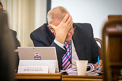 © Licensed to London News Pictures. 23/05/2016. Northallerton UK. Picture shows County Councillor Bob Packham showing signs of strain at Northallerton County Hall. A decision is expected today at Northallerton County Hall on wether to allow UK firm Third Energy to frack for shale gas in Kirby Misperton. Photo credit: Andrew McCaren/LNP