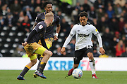 Derby County midfielder Duane Holmes on the ball as Sheffield Wednesday midfielder Barry Bannan challenges during the EFL Sky Bet Championship match between Derby County and Sheffield Wednesday at the Pride Park, Derby, England on 9 March 2019.