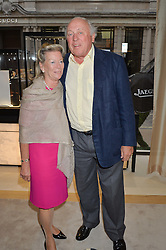 MAJOR CHRISTOPHER & MRS HANBURY at the draw for the Jaeger-LeCoultre Gold Cup held at Jaeger-LeCoultre, 13 Old Bond Street, London on 8th June 2015.