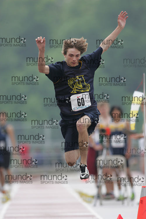 (London, Ontario}---03 June 2010) Jeremy Locke of Ange-Gabriel - Brockville competing in the long jump at the 2010 OFSAA Ontario High School Track and Field Championships. Photograph copyright Sean Burges / Mundo Sport Images, 2010.