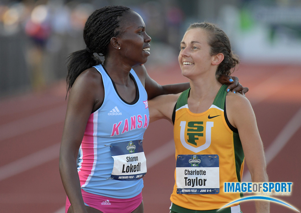 Jun 7, 2018; Eugene, OR, USA; Sharon Lokedi of Kansas (left) celebrates with Charlotte Taylor of San Francisco after winning the women's 10,000m in a meet record 32:09.20 during the NCAA Track and Field championships at Hayward Field.