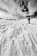 Backcountry skier under Piute Pass, John Muir Wilderness, Sierra Nevada Mountains, California