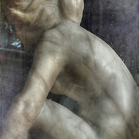 A marble sculpture of a naked young woman