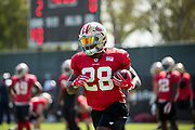 San Francisco 49ers running back Carlos Hyde (28) runs through drills during the San Francisco 49ers training camp held at their practice facility in Santa Clara, California, on August 17, 2017. (Stan Olszewski/Special to S.F. Examiner)