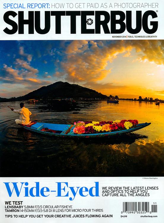 November 2014 cover photo of Shutterbug Magazine. Flower seller paddling his canoe on Dal Lake, Srinagar, Kashmir, India.