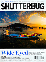 November 2014 cover photo of Shutterbug Magazine. Flower seller paddling his canoe on Dal Lake, Srinagar, Kashmir, India.