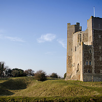 Orford Castle in Orford Suffolk, England on a warm spring day under blue sky