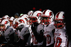 In the PIAA State Championship Imhotep Panthers advance to the Semi Finals with a 46-16 win over Academy Park Knights. (photo by Bastiaan Slabbers)<br /> <br /> Panthers are on one knee as team mate P1 lays injured on the field.