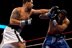 Apr 6, 2007; Uncasville, CT, USA; Matt Godfrey (white trunks) and Felix Cora Jr. (blue trunks) trade punches during their 12 round NABF and NABA Cruiserweight title bout at the Mohegan Sun Arena.