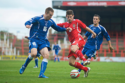 WREXHAM, WALES - Saturday, October 10, 2009: Wales' Ched Evans and Bosnia-Herzegovina's Toni Sunjic during the UEFA Under-21 Championship Qualifying Round Group 3 match at the Racecourse Ground. (Pic by Chris Brunskill/Propaganda)