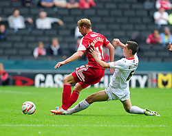 Bristol City's Scott Wagstaff is tackled by Milton Keynes Dons' Shaun Williams  - Photo mandatory by-line: Dougie Allward/JMP - Tel: Mobile: 07966 386802 24/08/2013 - SPORT - FOOTBALL - Stadium MK - Milton Keynes -  Milton Keynes Dons V Bristol City - Sky Bet League One