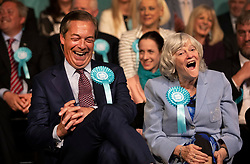 © Licensed to London News Pictures. 21/05/2019. London, UK. Brexit Party Leader Nigel Farage shares a joke with candidate Anne Widdecombe during a European Election rally at Olympia in London. Voters are due to go to the polls in two days. Photo credit: Peter Macdiarmid/LNP