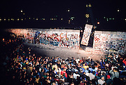 November 12, 1989. Berlin, Federal Republic of Germany. Berliners watch as a part of the Berlin Wall comes down at Potsdamer Platz to make way for a new border crossing between West?this side?and East Berlin. (Photo Heimo Aga)