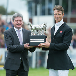 William Fox Pitt receives the Mitsubishi Motors Trophy from Lance Bradley, Managing Director of Mitsubishi Motors UK <br /> Mitsubishi Motors Badminton Horse Trials - Badminton 2015<br /> © Hippo Foto - Jon Stroud