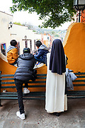 A Catholic Nun and children watch a parade to celebrate the 251st birthday of the Mexican Independence hero Ignacio Allende January 21, 2020 in San Miguel de Allende, Guanajuato, Mexico. Allende, from a wealthy family in San Miguel played a major role in the independency war against Spain in 1810 and later honored by his home city by adding his name.