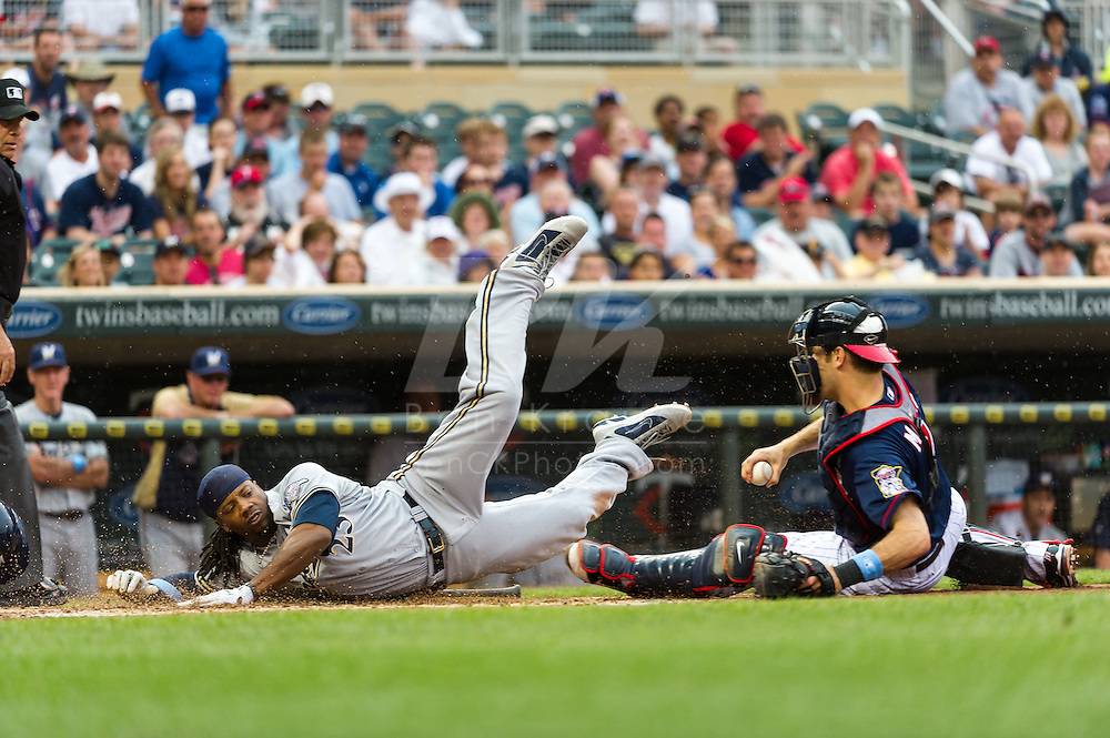 Milwaukee Brewers 2nd baseman Rickie Weeks is tagged out at home by Minnesota Twins catcher Joe Mauer at Target Field in Minneapolis, Minnesota on June 17, 2012.  The Twins defeated the Brewers 5 to 4 in 15 innings.  The game was the longest in Target Field history.  © 2012 Ben Krause
