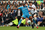 Wolverhampton Wanderers striker Benik Afobe and Derby County midfielder George Thorne challenge for the ball during the Sky Bet Championship match between Derby County and Wolverhampton Wanderers at the iPro Stadium, Derby, England on 18 October 2015. Photo by Aaron Lupton.