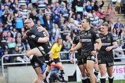 Hull FC outside back Jake Connor (14) scores the opening try and celebrates  during the Betfred Super League match between Hull FC and Hull Kingston Rovers at Kingston Communications Stadium, Hull, United Kingdom on 19 April 2019.