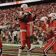 The University of Houston team celebrates an early touchdown.<br /> <br /> Todd Spoth for The New York Times.