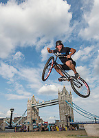 World trials record holder Andrei Burton at Tower Bridge celebrating Prudential RideLondon, the world's greatest festival  of cycling, which will involve 70,000+ cyclists –from Olympic champions to a free family fun ride - riding in five events over closed roads in London and Surrey this weekend (9 – 10 August). <br /> See www.PrudentialRideLondon.co.uk for more.<br /> <br /> Photo: Jon Buckle for Prudential Ride London<br /> <br /> For further information: Penny Dain 07799 170433<br /> pennyd@ridelondon.co.uk<br /> <br /> The attached picture is embargoed to 0001 BST Friday 8th August. This image is provided in advance under embargo and solely for the purpose of page-planning.<br /> The picture, or pages featuring the picture, must not be tweeted or used on any social media or website until after 0001 Friday 8th August (UK BST), and by receiving this picture you are agreeing to adhere to this embargo. This image is supplied for: EDITORIAL USE ONLY.