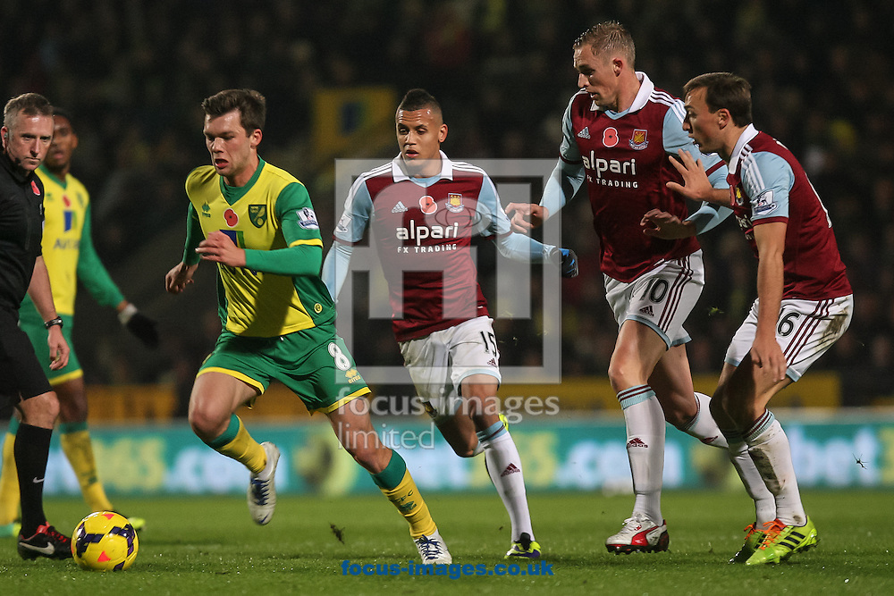 Picture by Daniel Chesterton/Focus Images Ltd +44 7966 018899<br /> 09/11/2013<br /> Jonny Howson of Norwich City on the ball flanked by Ravel Morrison of West Ham United, Jack Collison of West Ham United and Mark Noble of West Ham United during the Barclays Premier League match at Carrow Road, Norwich.