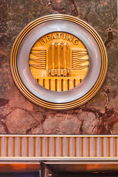 A machine-age, Art Deco, brass medallion, or roundel on the Empire State Building's marble-walled lobby -- one of 11 such roundels, each honoring a different technology or craft essential to the construction of the great building.
