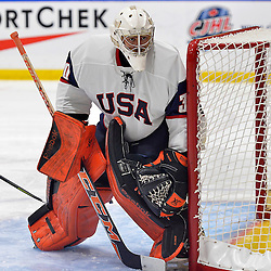WHITBY, - Dec 17, 2015 -  Game #10 - United States vs. Russia at the 2015 World Junior A Challenge at the Iroquois Park Recreation Complex, ON.  Kris Oldham #30 of Team United States follow the play during the third period.<br /> (Photo: Shawn Muir / OJHL Images)