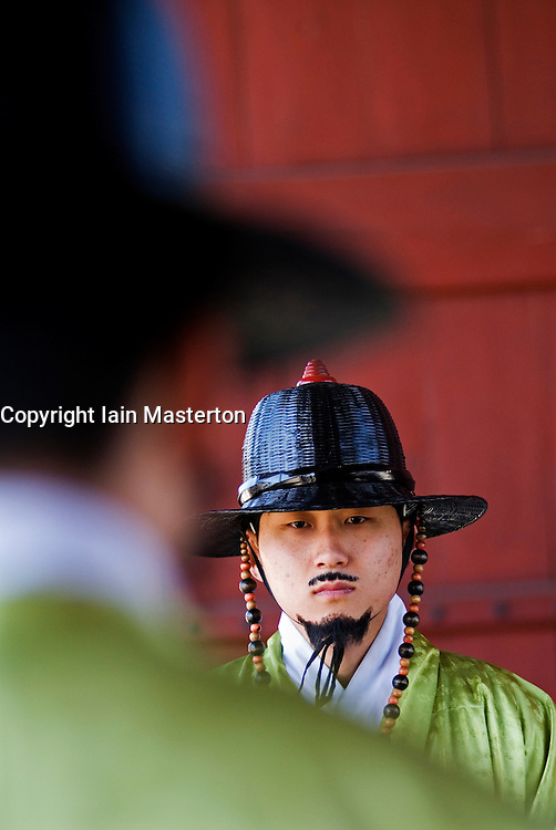 Detail of ceremonial guards in traditional uniform at Gyeongbokgung Royal Palace Seoul South Korea