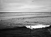 Surfers off Pleasure Point, Aptos, CA