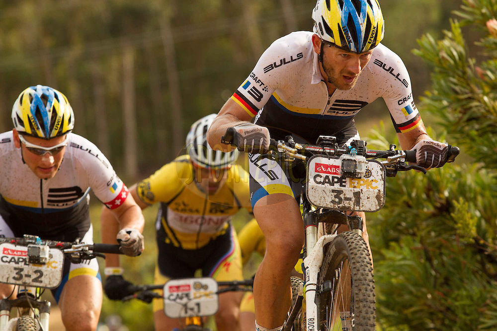 Karl Platt and Urs Huber of Team Bulls do al they can to break away from overall leaders Team Burry Stander-SONGO during stage 6 of the 2013 Absa Cape Epic Mountain Bike stage race from Wellington to Stellenbosch, South Africa on the 23 March 2013..Photo by Greg Beadle/Cape Epic/SPORTZPICS