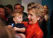 Senator Hillary Clinton plays with one-year-old Max Weitzman of Sacramento during day two of the California Democratic Convention in San Diego, Saturday April 28, 2007. He was there with his parents, Randi and Dan Weitzman.