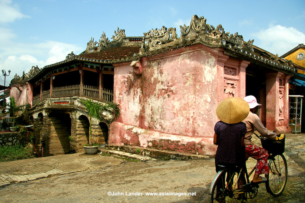Japanese Covered Bridge, Hoi An.  This  bridge used to join the Japanese sector of the town with the Chinese one. It has lasted since the year 1593 when it was constructed and still used today by foot traffic and cyclists.  Inside the bridge there is a small temple and the two entrances of the bridge are guarded by a pair of dogs on one side and monkeys on the other.