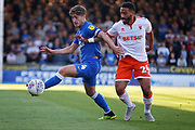 Peterborough United midfielder Alex Woodyard (4) shields the ball from Blackpool midfielder Liam Feeney (24) during the EFL Sky Bet League 1 match between Peterborough United and Blackpool at The Abax Stadium, Peterborough, England on 29 September 2018.