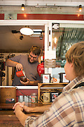 The Olé Latte Coffee Food Cart at the SW Alder Food Pod in Portland, Oregon serves unique coffee drinks and has their own brand of coffee.