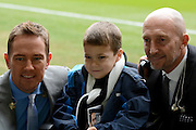 Ian Holloway and Simon Thomas pose for a picture with a young fan during the Sky Bet Championship match between Derby County and Wolverhampton Wanderers at the iPro Stadium, Derby, England on 18 October 2015. Photo by Alan Franklin.