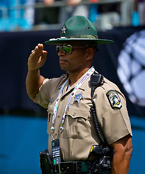CHARLOTTE, USA - Sunday, July 22, 2018: An American policeman (Sheriff) stands with a salute during the playing of the national anthem before a preseason International Champions Cup match between Borussia Dortmund and Liverpool FC at the  Bank of America Stadium. (Pic by David Rawcliffe/Propaganda)